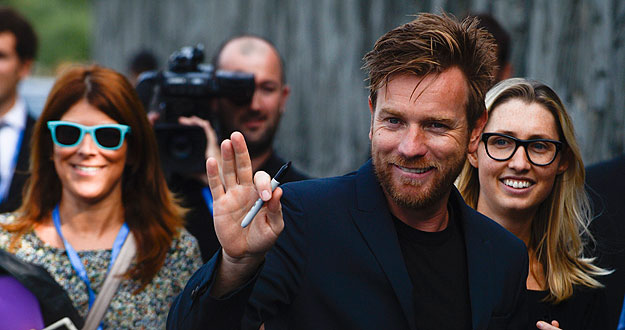 "Actor McGregor waves to fans after photocall to promote movie ""The Impossible"" on the seventh day of the 60th San Sebastian Film Festival"