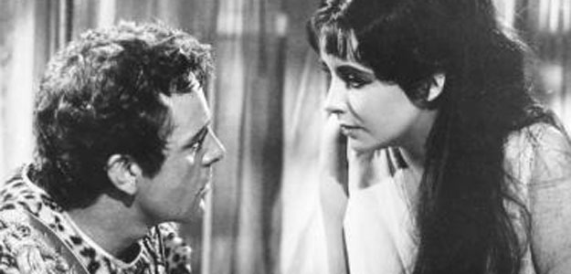 Actress Elizabeth Taylor and Richard Burton are shown in a scene from her 1963 film Cleopatra