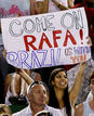A fan holds up a banner for Spain's Nadal during his men's singles final match against Switzerland's Federer at the Australian Open