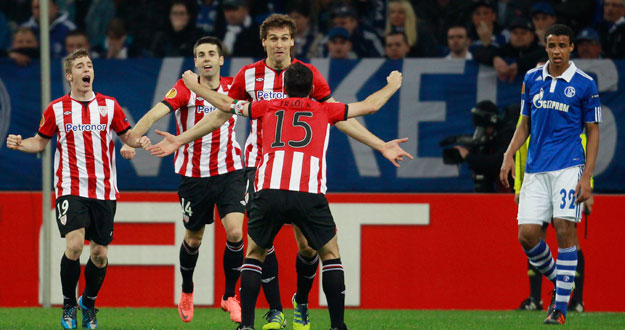 Athletic Bilbao's Llorente and Iraola celebrate a goal against Schalke 04 during the Europa League quarter-final match in Gelsenkirchen