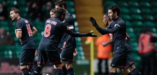 Atletico Madrid's Turan celebrates with teammates after scoring against Celtic during their Europa League Group I soccer match at Celtic Park stadium in Glasgow