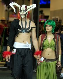 Attendees arrive in costume for the third day of the pop culture convention Comic Con in San Diego