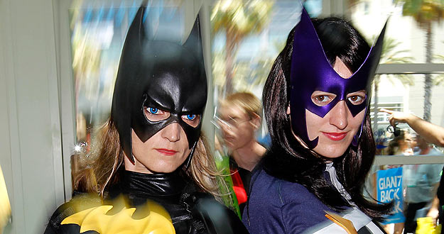 Attendees in costume arrive for the third day of the pop culture convention Comic Con in San Diego