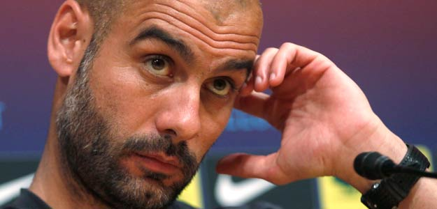 Barcelona's coach Pep Guardiola attends a news conference at Nou Camp stadium in Barcelona