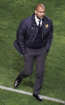 Barcelona's coach Pep Guardiola walks before their Spanish First division soccer league match against Rayo Vallecano at Vallecas stadium in Madrid