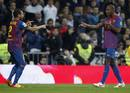 Barcelona's Eric Abidal celebrates his goal with teammate Dani Alves against Real Madrid during their Spanish King's Cup soccer match in Madrid