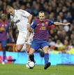 Barcelona's Iniesta is challenged by Real Madrid's Benzema during their Spanish King's Cup soccer match in Madrid