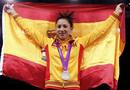 Silver medallist Spain's Brigitte Yague Enrique holds up a national flag at the women's -49kg taekwondo victory ceremony during the London 2012 Olympic Games at the ExCeL arena