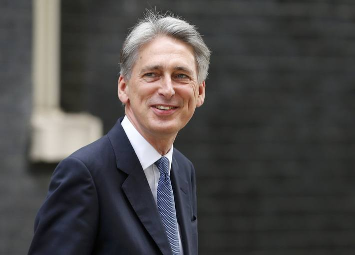 Britain's new Foreign Secretary Philip Hammond arrives at 10 Downing Street in central London