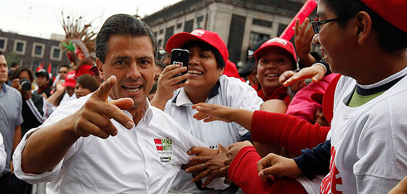 Mexican presidential front-runner Enrique Pena Nieto greets supporters at one of his last campaign rallies in Toluca
