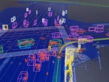 Esto es lo que ve el coche de Google con sus sensores, un mundo compuesto de bloques en movimiento.