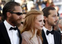Cast members Hardy Labeouf and Chastain arrive on the red carpet for the screening of the film Lawless at the 65th Cannes Film Festival