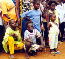 CHILD AMPUTEES WAIT FOR A VISIT BY CANADI