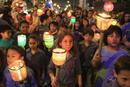 Children march while holding candles during Earth Hour in Lima