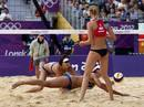 China's Xue Chen and Zhang Xi try to save the ball against Russia's Ekaterina Khomyakova during their women's round of 16 beach volleyball match at Horse Guards Parade during the London 2012 Olympic Games