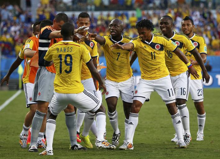 Colombia's team celebrates Cuadrado's goal against Japan during 2014 World Cup Group C soccer match at Pantanal arena in Cuiaba