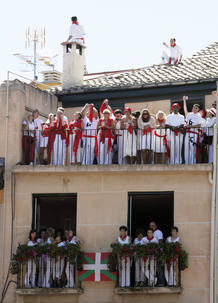People watch revellers from balconies at the start of the San Fermin festival in Pamplona
