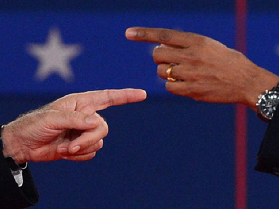 Un cruce de acusaciones resumida en una instantánea. Así se puede resumir esta foto de la campaña electoral estadounidense, que se disputaron Mitt Romney y Barack Obama.