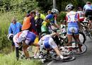 Cyclists try to recover from a crash during the women's cycling road race final at the London 2012 Olympic Games