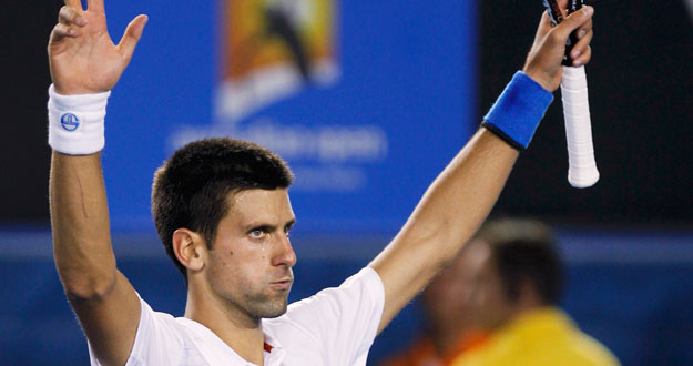 Djokovic of Serbia celebrates after defeating Ferrer of Spain during their quarter-final match at the Australian Open in Melbourne