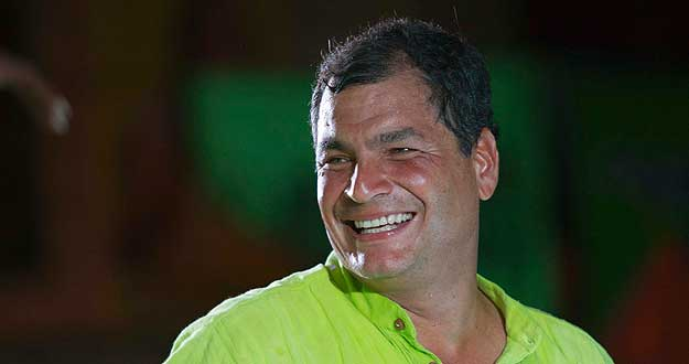 Ecuador's President Correa smiles during his closing political rally in Guayaquil