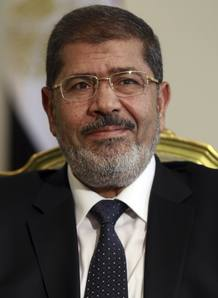 Egypt's president Mursi attends a meeting with U.S. Secretary of Defense Panetta at the presidential palace in Cairo