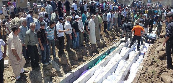 Entierros de las víctimas de la matanza de Hula, en Siria