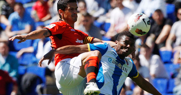 Espanyol's Uche fights for the ball with Valencia's Costa during their Spanish First division soccer league match near Barcelona
