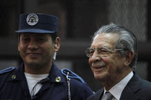 Former Guatemalan dictator Rios Montt smiles during a break at the Supreme Court of Justice in Guatemala City