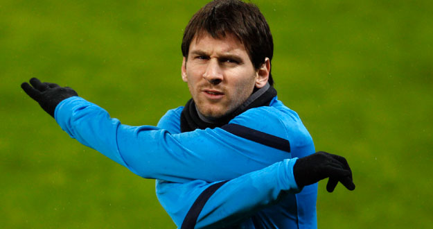 FC Barcelona's Messi warms up during a training session in Leverkusen