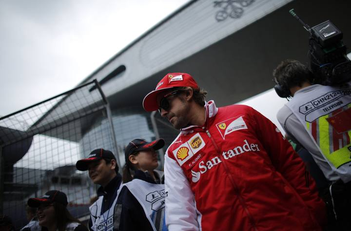 Ferrari Formula One driver Fernando Alonso of Spain walks during the Chinese F1 Grand Prix at the Shanghai International Circuit