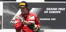 Ferrari's Alonso of Spain sprays champagne on the podium after taking the second place at the European F1 Grand Prix in Valencia