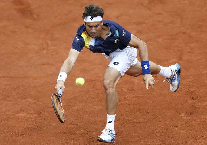 Ferrer of Spain hits a return to Sijsling of the Netherlands during their men's singles match at the French Open tennis tournament at the Roland Garros stadium in Paris