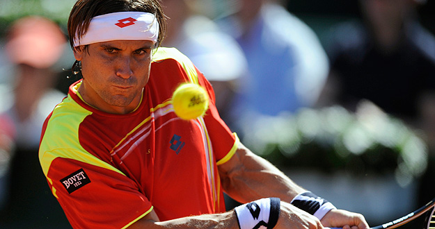 Ferrer of Spain returns a shot to Querrey of the U.S. during their Davis Cup World Group semi-final match in Gijon