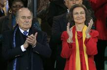 FIFA President Blatter claps next to Spain's Queen Sofia before the 2010 World Cup semi-final soccer match between Germany and Spain in Durban