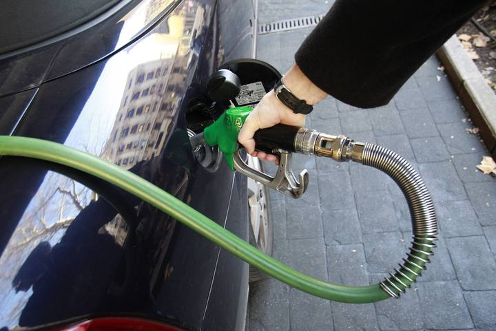 File photo of a driver refueling his car