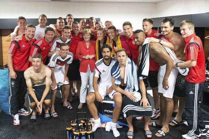 File photo of German Chancellor Merkel posing with the German national soccer squad in Salvador