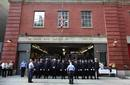 Firefighters observe a moment of silence at FDNY firehouse Hook & Ladder 24 Engine 1 during ceremonies marking the 10th anniversary of the 9/11 attacks on the World Trade Center, in New York