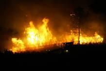 A forest fire rages near the Spanish town of Santa Maria del Espino near Guadalajara.