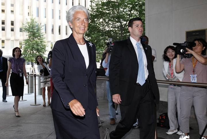 Former French Finance Minister Christine Lagarde arrives at the International Monetary Fund headquarters for her first day as head of the IMF in Washington
