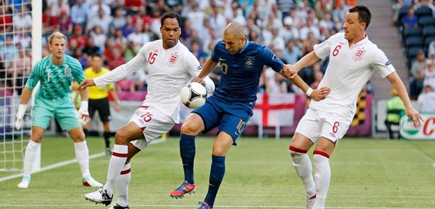 France's Benzema controls the ball next to England's Lescott and Terry during the Group D Euro 2012 soccer match against France at Donbass Arena in Donetsk