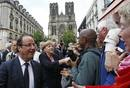 France&#146;s President Hollande and Germany&#146;s Chancellor Merkel shake hands with the crowd in Reims