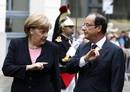 France&#146;s President Hollande listens to Germany&#146;s Chancellor Merkel as they attend the 50th anniversary ceremony of a reconciliation meeting in Reims