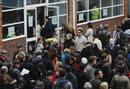 French nationals queue to cast their votes in France's Presidential election at the Lycee Francais Charles de Gaulle in London