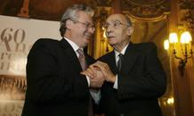 Garzón con José Saramago en una conferencia en Lisboa