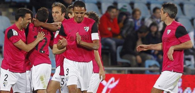 Los jugadores del Málaga CF celebran un gol en Getafe