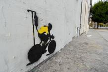 Grafiti en una calle de Los Ángeles caricaturizando la figura de Lance Armstrong
