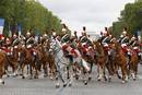 The French Republican Guard ride down the Champs Elysees during the traditional Bastille Day military parade in Paris