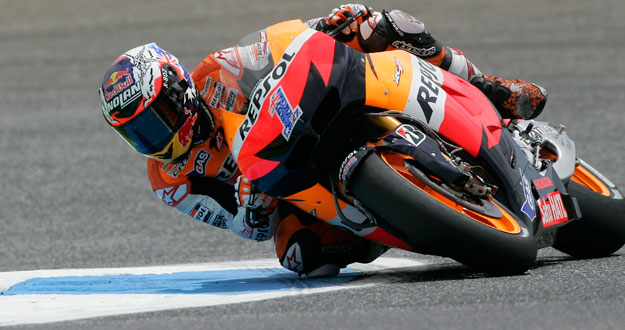 Honda MotoGP rider Casey Stoner of Australia rides his motorcycle during the second free practice session at the Portuguese Grand Prix in Estoril