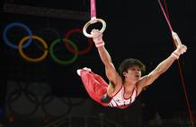 Kohei Uchimura of Japan competes in the rings during the men's individual all-around gymnastics final in London